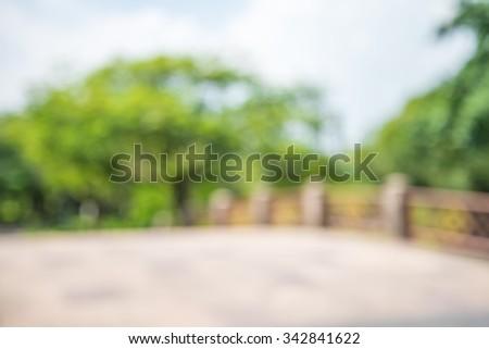 Abstract blur bridge in city park bokeh background - stock photo