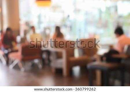 abstract blur businessman sitting in the restaurant cafe bar background:blurred of business meeting/discussing/advertising in the coffee shop concept:blurry lifestyle urban:image with vintage tone. - stock photo