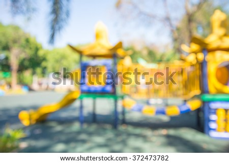Abstract blur children playground in city park background in sunny day - stock photo