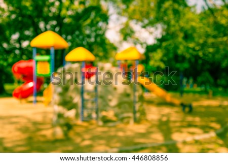 Abstract blur children playground in city park background - Vintage filter effect - stock photo