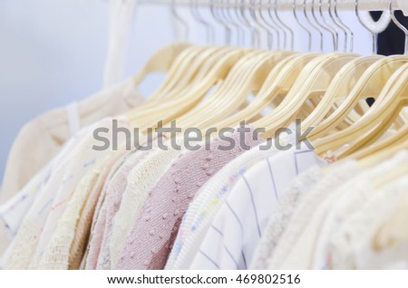 Abstract blur clothes hangers with blur and vignette background.