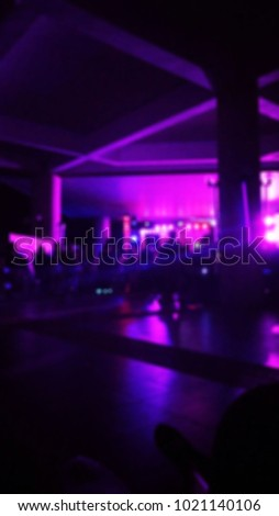 Abstract blur concert stage lights with crowd of people in front of the concert stage, colorful  concert  light background at the night,party with the the dark,technology for entertainment