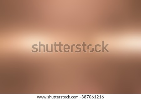 abstract blur copper bronze alloy metallic surface background concept:blurry sparkle shine backdrop:blurred golden gradient metal light wallpaper conceptual:christmas festive and happy new year card. - stock photo