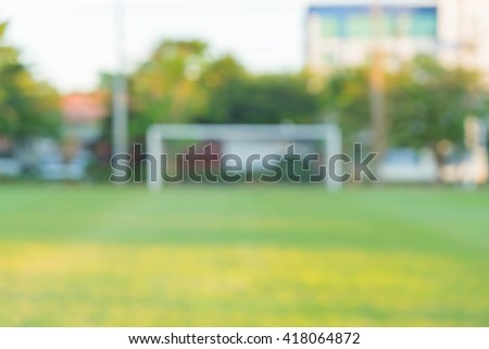 abstract blur green soccer field - stock photo