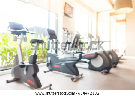 Abstract blur gym and fitness room with sport equipment interior for background - Sunflare filter