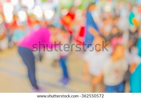 Abstract blur image of people at school activity for background usage . - stock photo