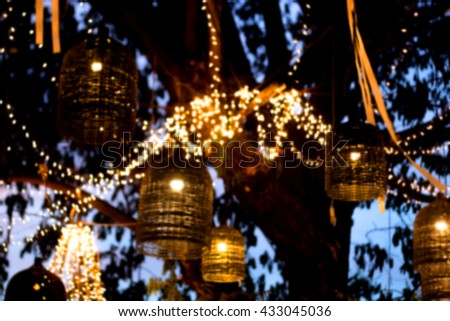 abstract blur lamp decoration garden at night - stock photo