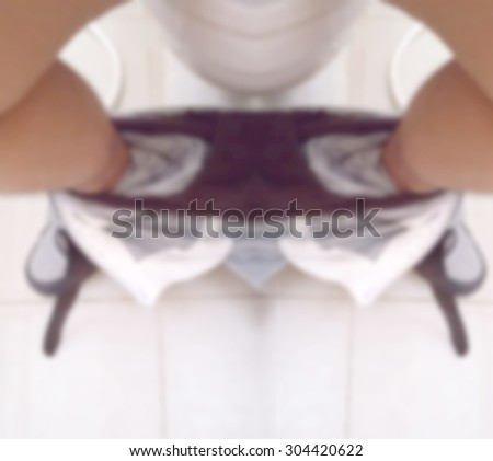 abstract blur man on a toilet . - stock photo