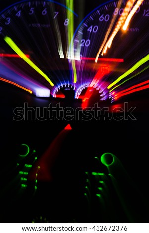 abstract blur of car's Speedometer illuminated