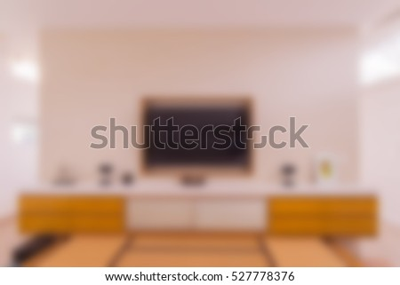 Abstract blur of living room wall with TV, cabinets and bed can be used as background images