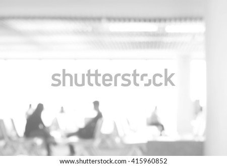 Abstract blur of passengers waiting at the gate to the plane with bokeh light. White blur abstract for background concept. - stock photo
