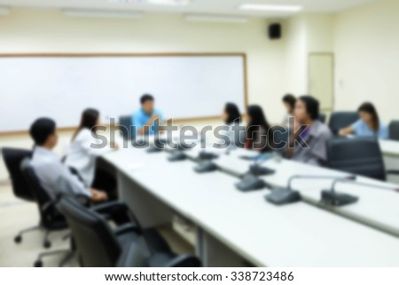 Abstract blur people Having Board Meeting In Office - stock photo