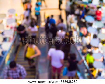 Abstract blur people in escalators at the modern shopping mall. - stock photo