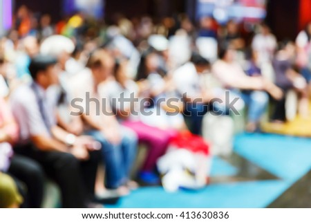 Abstract blur people or audience in convention hall - stock photo