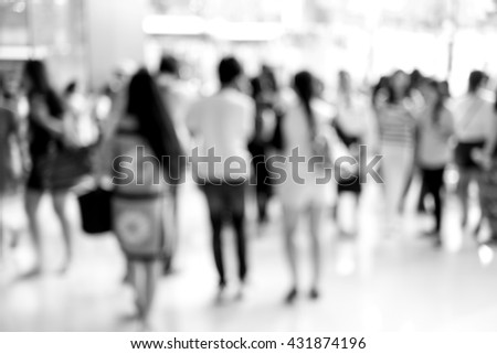 Abstract blur people walking in fashion mall. black and white color filter. - stock photo