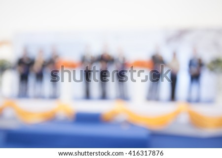 Abstract Blur Person Cutting the ribbon in Grand Opening - stock photo