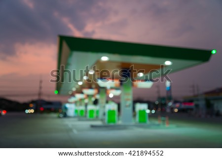 Abstract blur petrol gas station in evening twilight background - stock photo