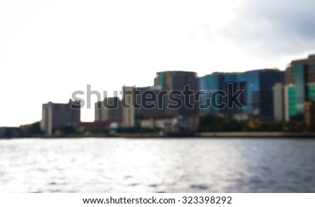 Abstract blur photo the big city and the river. - stock photo