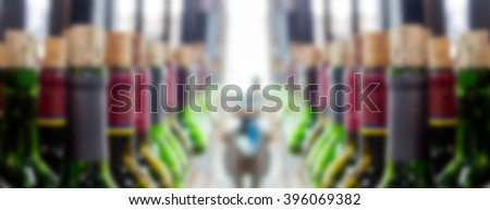 abstract blur vine bottle in shelf of restaurant - stock photo