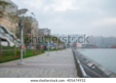 Abstract blur walkway in seaside city park background - stock photo