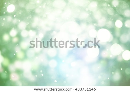 abstract blurred and silver glittering shine bulbs lights background:blur of Christmas wallpaper decorations concept.holiday festival backdrop:sparkle circle lit celebrations display. - stock photo