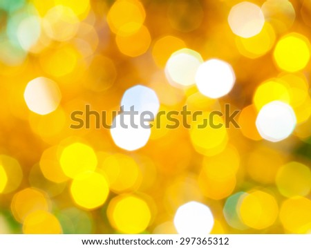 abstract blurred background - bright yellow and green shimmering Christmas lights bokeh of electric garlands on Xmas tree - stock photo