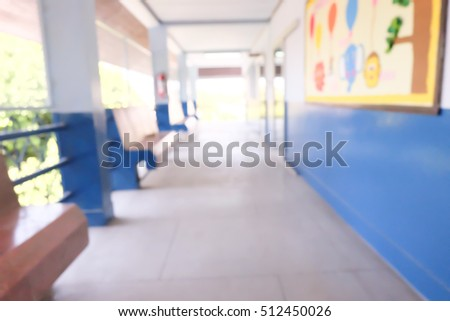 Abstract blurred background image of empty pathway at school.