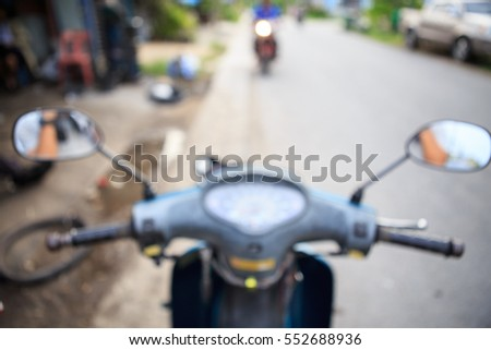 Abstract blurred background image of front motorcycle