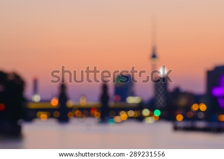 abstract blurred background of Berlin with TV Tower, Oberbaumbruecke and Spree River at evening, Germany, Europe - stock photo