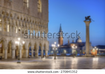 abstract blurred background of Doges Palace (Palazzo Ducale) and San Giorgio di Maggiore church in the background seen from Saint Mark square at blue hour, Venice, Venezia, Italy, Europe - stock photo