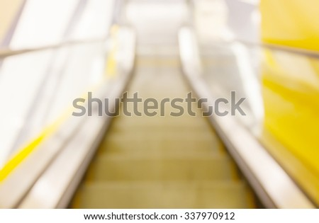 Abstract blurred background of looking down view escalator in an office building. - stock photo