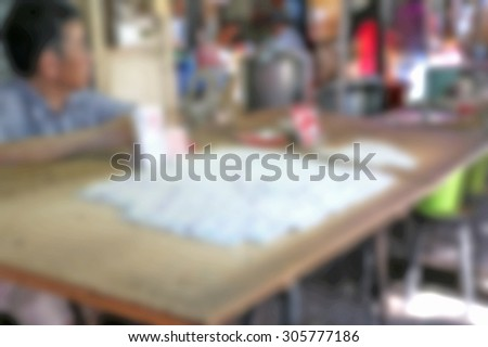 Abstract Blurred Background with Lottery Ticket Stand.