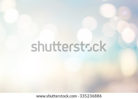 abstract blurred backgrounds of twilight backdrop with circle lights in pastel tone colour.blur of bokeh circle light christmas festive backdrop concept. - stock photo