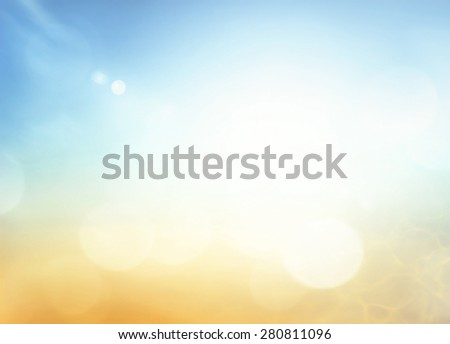 Abstract blurred beautiful the beach and sky textured background: yellow, orange, green, blue patterns. Sandy beach backdrop with turquoise water and bright sun light. Summer holiday Spring concept. - stock photo