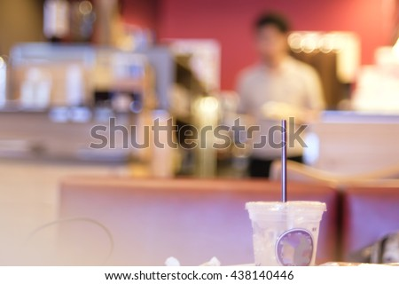 Abstract blurred bokeh background image of coffee shop in vintage style