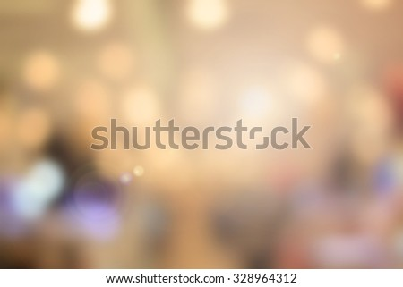 abstract blurred bokeh circle lights golden backgrounds:blurry of shiny gold backdrop for work about card,design,decor or et :christmas seasonal background concept.yellow gold color wallpaper. - stock photo