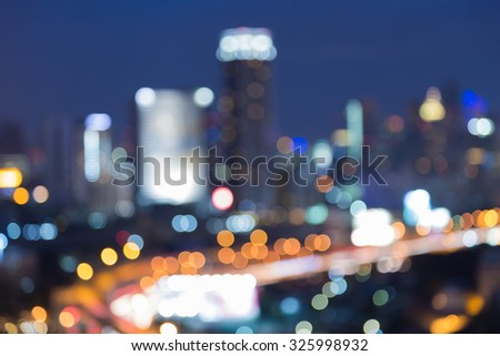 Abstract blurred bokeh city road with office building background - stock photo