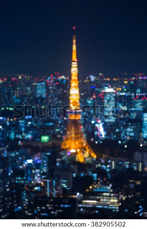 Abstract blurred bokeh lights background Tokyo city night - stock photo