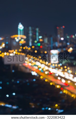 Abstract blurred bokeh lights city road at night - stock photo