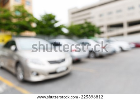 Abstract blurred car in outdoor parking lot at daytime - stock photo