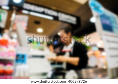 abstract blurred cashier at supermarket checkout  in department store. - stock photo