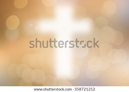 abstract blurred christ cross sign/symbolic over gold color background with bokeh circle bulbs lights:blur religious backdrop concept:blurry powerful/faithful/hopeful of religion conceptual. - stock photo
