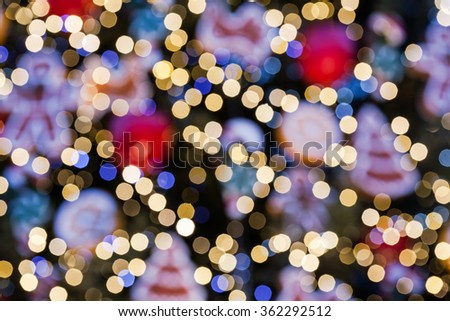 Abstract blurred christmas backgound, defocused multi color lights. - stock photo