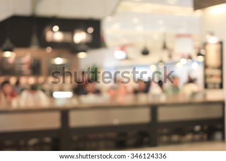 abstract blurred coffee cafe shop background:blur of coffee bar interior backdrop:people city lifestyle concept.leisure activity conceptual:happy Sunday concept.vintage colored tone style display. - stock photo