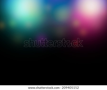 Abstract blurred color lghts background with black copy space. - stock photo