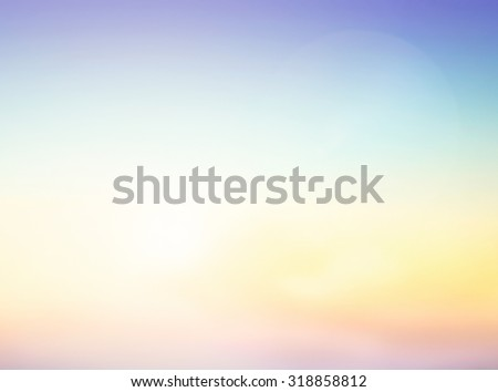 Abstract blurred colorful rainbow textured background: yellow and blue patterns. Sandy beach backdrop with turquoise water and bright sun light. - stock photo