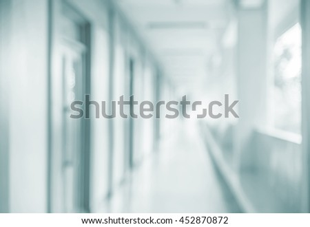Abstract blurred corridor as background, blurred abstract background from building hallway. - stock photo