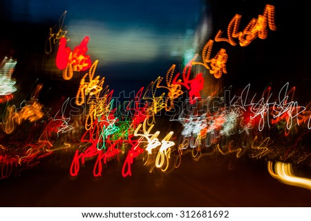 Abstract blurred defocused city motion effect on the street with cars