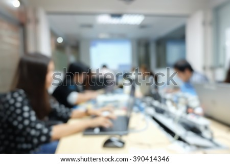 abstract blurred employee thoughtful about programming system:blur people working/researching data information concept:blur group of computer/network engineering focus assignment at notebook laptop. - stock photo