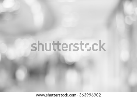 abstract blurred flash white/grey color corridor indoor office room background:blurry workplace factory backdrop concept:blur light and soft wallpaper with bokeh light:soft focus indoor working center - stock photo